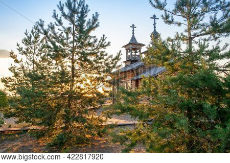 Small Wooden Russian-orthodox Church. Wooden Orthodox Church Against Blue Sky On Sunny Day - Image