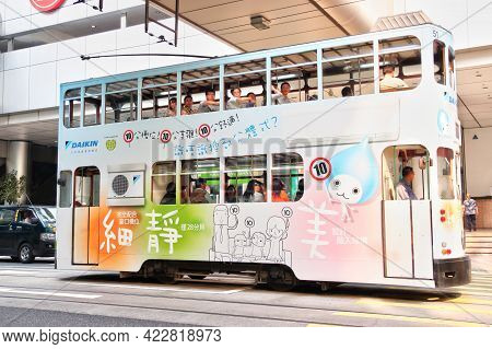 Hong Kong - Apr. 19, 2011:  An Electric Tram Bus In The Downtown Central District Of Hong Kong. Sinc
