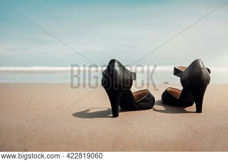 Work Life Balance Concept. Business Woman Take Off Working Shoes And Leave It On The Sand Beach For