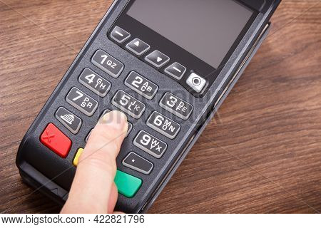 Hand Of Woman Using Credit Card Reader To Enter Pin Code. Cashless Paying. Finance And Banking Conce