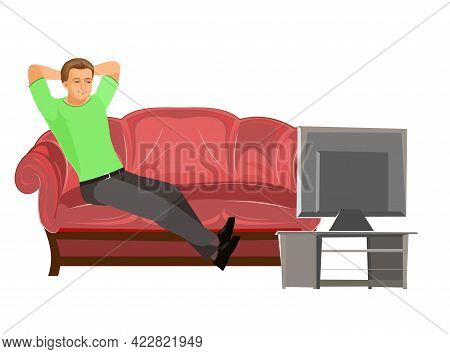 Guy Is Sitting On Couch. Young Handsome Handsome Boy Watching Tv. Resting. In Jeans, A T-shirt And S