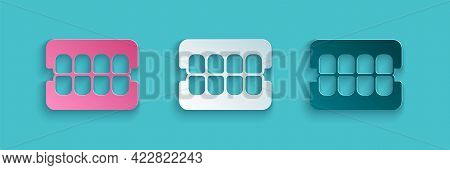 Paper Cut False Jaw Icon Isolated On Blue Background. Dental Jaw Or Dentures, False Teeth With Incis