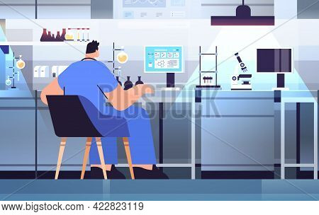Man Research Scientist Working With Test Tube In Lab Researcher Making Chemical Experiment In Labora