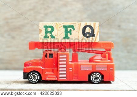 Fire Ladder Truck Hold Letter Block In Word Rfq (abbreviation Of Request For Quotation) On Wood Back
