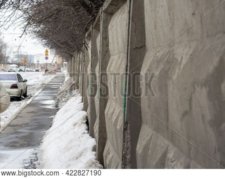 Gray Concrete Fence With A Diamond Shape. Road, View Along The Fence. Russian Fence