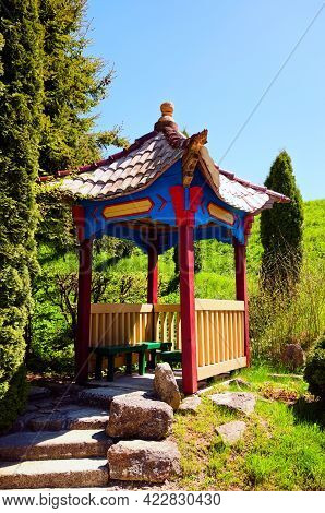 Zolochiv, Ukraine-may 11,2021:picturesque View Of Wooden Chinese Style Arbor In Zolochiv Castle. Bea