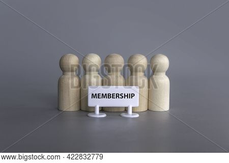 A Wooden People Standing In A Row With A Signboard Of Membership.