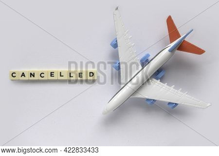 Top View Of Toy Plane Or Flight With A Text Of Cancelled.