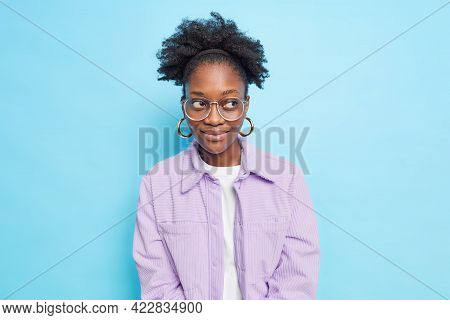 Portait Of Pensive Satisfied Dark Skinned Model Has Charming Look Focused Away With Dreamy Expressio