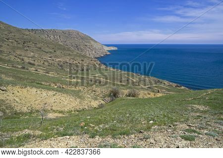 A Small Deserted Cove At The Southern End Of Cape Meganom. Crimea. Sunny Day At The End Of April.