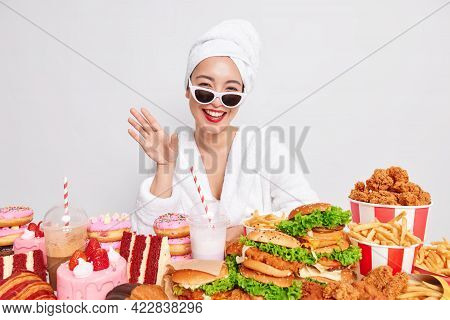 Unhealthy Lifestyle Gluttony And Harmful Nutrition. Positive Young Asian Woman Wears Sunglasses Towe
