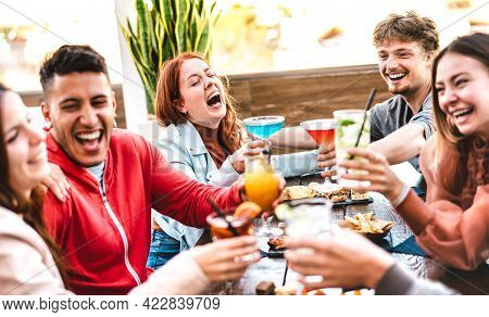 Friends Toasting Multicolored Drinks At Open Air Bar Restaurant After Work - Life Style Concept With