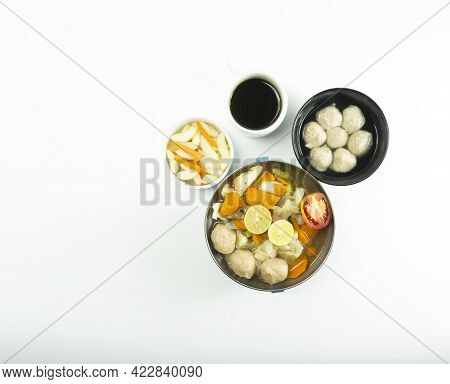 Omelet, Pickled Cucumber Meatballs And Meatball Soup On A White Background.