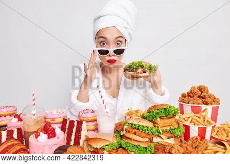 Unhealthy Eating And Junk Food Concept. Surprised Asian Woman Wears Sunglasses Bathrobe And Soft Tow