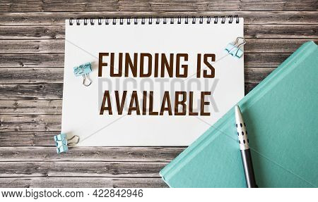 Financing Available, Text On Notepad And Wooden Table Sponsored Financing Business Startup Projects