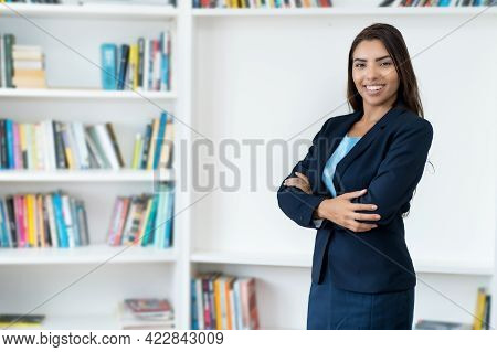 Beautiful Mexican Female Business Trainee At Office Of Company
