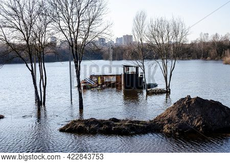 A Flooded Boat Base Where People Played Sports. Flooded River Valley