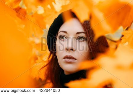 Autumn Portrait Of Red-haired Woman. Beautiful Girl In A Beret Among The Leaves. Maple Park. Romanti