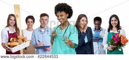 Young Afro American Female Nurse With Group Of International Apprentices Isolated On White Backgroun