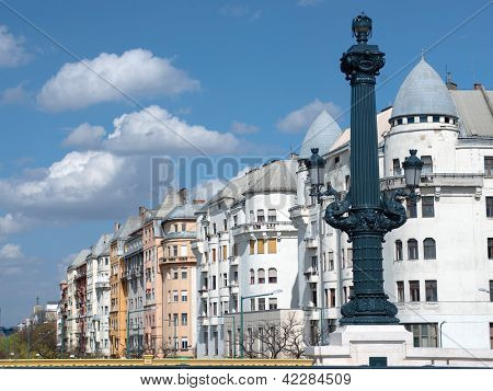 Budapest: artistic street lamp on Chain bridge and typical architecture of palaces on the Danube riverside of Pest