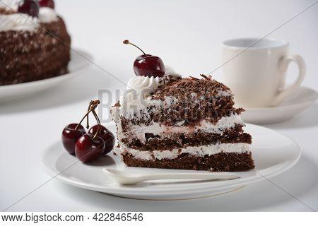 Black Forest Cake, Schwarzwald Pie, Dark Chocolate And Cherry Dessert On A White Background. Black F
