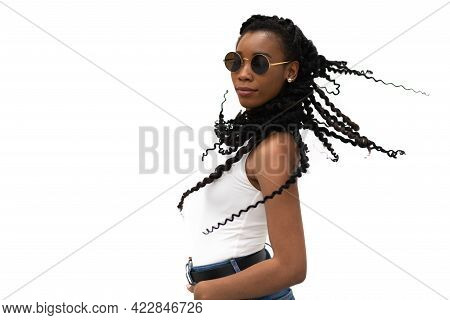 Elegant And Pretty Young African American Woman With Typical Hairstyle On A Light Background: Select