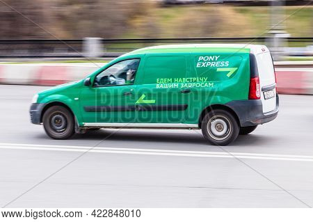 Moscow , Russia - May 2021: Delivery Van Of The Pony Express Expedition Company In Motion On The Roa