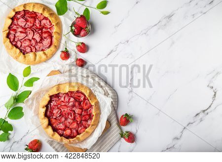 Fresh Homemade Galettes With Strawberries On White Marble Background. Top View. Space For Text.