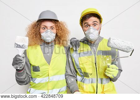 Shocked Experienced Maintenance Workers Paint Apartment Busy Doing Renovation Repair And Redecoratio
