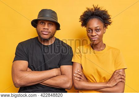 Two Serious Afro American Brother And Sister Stand Next To Each Other Keep Arms Folded Have Determin
