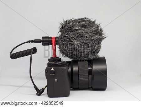Shotgun Mic With Windshield And Mic Jack Cable On Mirrorless Camera Isolated On White Background.