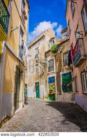 Lisbon, Portugal - March 25, 2017: Narrow Old Streets With Vintage Balconies Of Alfama District, Lis