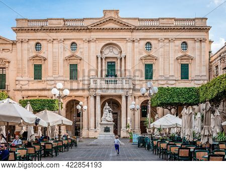 Valletta, Malta - February 20 2015: A Little Boy Runs After A Pigeon At Republic Square. The Nationa