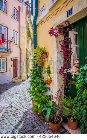 Lisbon, Portugal - March 25, 2017: Beautiful Facade Of An Old House With Plants. Narrow Old Streets