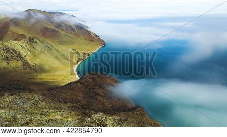 Beautiful Shore Of Baikal Lake With Clear Blue Water And Mountains. Aerial Drone View. Baikal Lake,