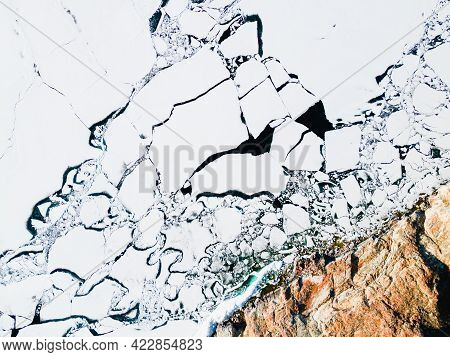 Melting Ice On The Shore Of Baikal Lake In Spring. Aerial Drone View. Baikal Lake, Siberia, Russia
