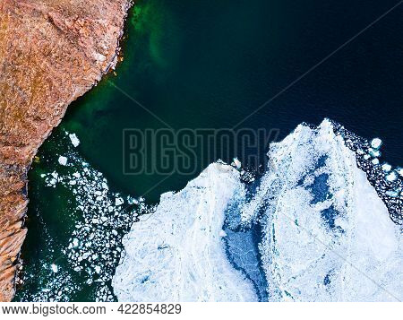 Melting Ice Floes On The Shore Of Baikal Lake In Spring. Aerial Drone View. Baikal Lake, Siberia, Ru