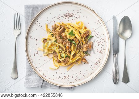 Braised Rabbit With Rosemary, Garlic And Pasta Tagliatelle Or Pappardelle Set, On Plate, On White St