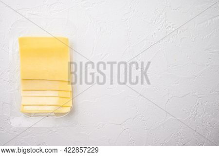Yellow Cheese Slices Of Cheddar Set, In Plastic Pack, On White Stone  Background, Top View Flat Lay,