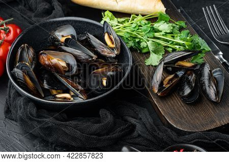 Boiled Mussels In Shells With Spices And Herb, In Bowl, On Black Background
