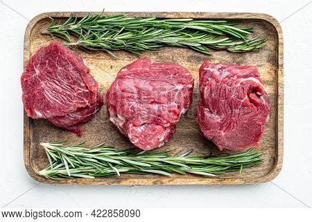 Prime Raw Fillet Mignon Tenderloin Steaks Set, On White Stone  Surface, Top View Flat Lay