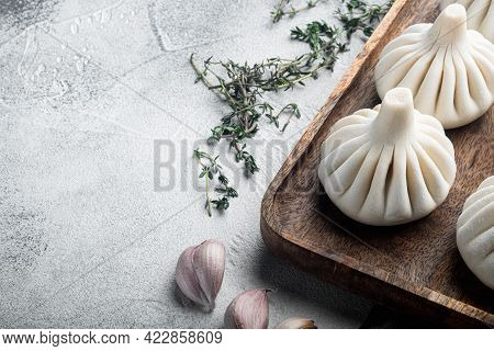 Uncooked Baozi Chinese Dumplings. Azian Dumplings Set, On Gray Stone Background, With Copy Space For