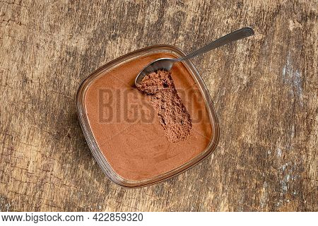 Traditional French Chocolate Mousse In A Bowl And A Spoon On The Old Wooden Background, Top View