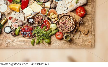 Top View Table Full Of Food. Italian Antipasti Wine Snacks Set. Cheese Variety, Nuts, Mediterranean