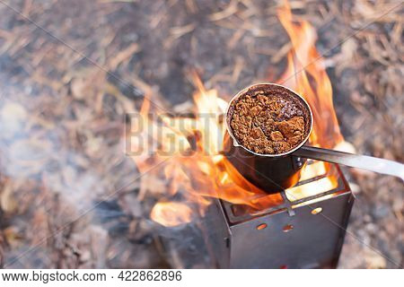 Coffee In Turk Is Brewed In A Small Stove On An Open Fire In Nature, In The Fresh Air.