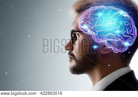 Close Up Portrait Of A Man From The Side In Profile And A Hologram Of A Working Brain. The Concept O