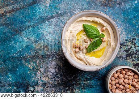 Bowl Of Healthy Homemade Creamy Chickpea Hummus Dip With Olive Oil, Top View