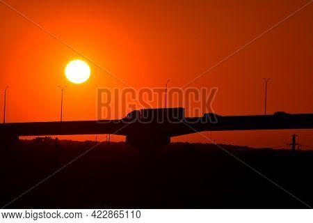 Sunset Over The Savannah, Georgia River Bridge Background.
