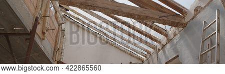 Construction Building Site With The Wooden Old Beams Roof, Reinforced Concrete Beam And Brick, Scaff