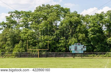 A Football Goal Post And Old Scoreboard On A Field In Swissvale, Pennsylvania, Usa On A Sunny Day